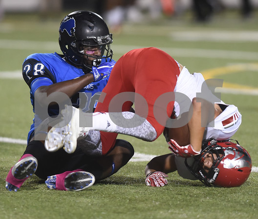 John Tyler High School's Martrevious Allison takes down Mesquite Horn's Darryan Riley during their game Friday night at Christus Trinity Mother Frances Rose Stadium.  (Sarah A. Miller/Tyler Morning Telegraph)