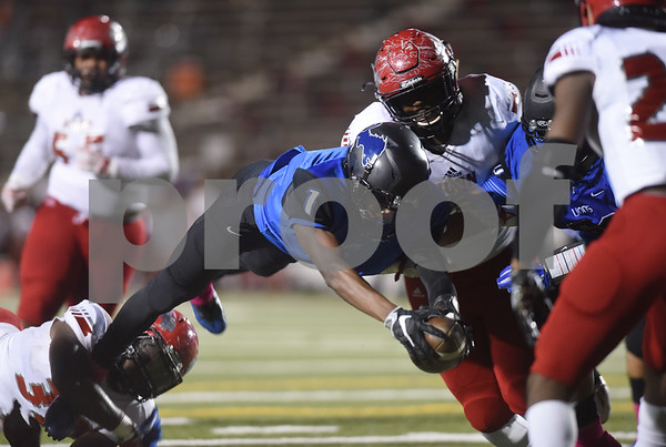 John Tyler High School's Bryson Smith dives into the end zone for a touchdown during their game Friday night against Mesquite Horn at Christus Trinity Mother Frances Rose Stadium.  (Sarah A. Miller/Tyler Morning Telegraph)