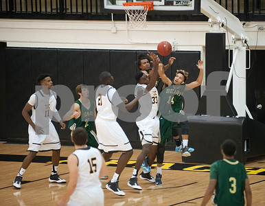 Tyler Junior College's (33) Brandon Simmons and Brookhaven College's (14) Cameron Kocik both try to grab the basketball after a missed shot Friday Oct. 30, 2015 at Wagstaff Gymnasium.  (Sarah A. Miller/Tyler Morning Telegraph)
