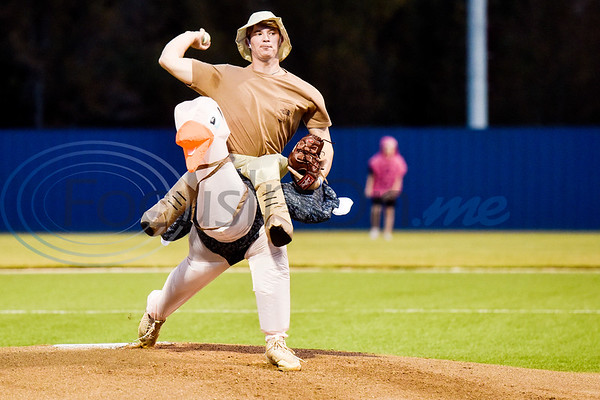 A Lindale baseball player dressed as Steve Irwin pitches during the Lindale High School baseball Halloween game in Lindale Texas, on Tuesday, Oct. 30, 2018. Athletes played in Halloween costumes and kids were able to run the bases to collect candy before the game. (Chelsea Purgahn/Tyler Morning Telegraph)