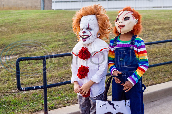 Kannon Smith, 8, as Pennywise and Tyce Holloway, 7, as Chuckie at the Lindale High School baseball Halloween game in Lindale Texas, on Tuesday, Oct. 30, 2018. Athletes played in Halloween costumes and kids were able to run the bases to collect candy before the game. (Chelsea Purgahn/Tyler Morning Telegraph)
