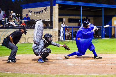 A Lindale player dressed in a blue inflatable costume swings during the Lindale High School baseball Halloween game in Lindale Texas, on Tuesday, Oct. 30, 2018. Athletes played in Halloween costumes and kids were able to run the bases to collect candy before the game. (Chelsea Purgahn/Tyler Morning Telegraph)