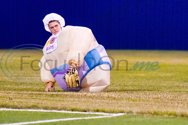 Lindale baseball player Cody Pike dressed as a baby bends to pick up the ball during the Lindale High School baseball Halloween game in Lindale Texas, on Tuesday, Oct. 30, 2018. Athletes played in Halloween costumes and kids were able to run the bases to collect candy before the game. (Chelsea Purgahn/Tyler Morning Telegraph)