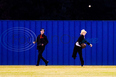 A Lindale player dressed as a gangster laughs as his teammate dressed as Donald Trump throws the ball during the Lindale High School baseball Halloween game in Lindale Texas, on Tuesday, Oct. 30, 2018. Athletes played in Halloween costumes and kids were able to run the bases to collect candy before the game. (Chelsea Purgahn/Tyler Morning Telegraph)
