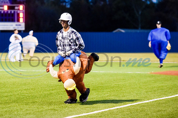 A Lindale player dressed as a bull rider runs back to the dugout after being tagged out at first base during the Lindale High School baseball Halloween game in Lindale Texas, on Tuesday, Oct. 30, 2018. Athletes played in Halloween costumes and kids were able to run the bases to collect candy before the game. (Chelsea Purgahn/Tyler Morning Telegraph)