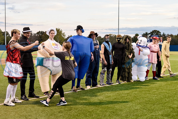 Lindale baseball players line up during the Lindale High School baseball Halloween game in Lindale Texas, on Tuesday, Oct. 30, 2018. Athletes played in Halloween costumes and kids were able to run the bases to collect candy before the game. (Chelsea Purgahn/Tyler Morning Telegraph)