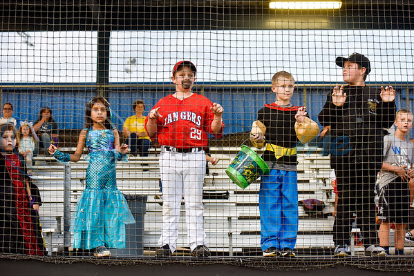 Kids in Halloween costumes watch the Lindale High School baseball Halloween game in Lindale Texas, on Tuesday, Oct. 30, 2018. Athletes played in Halloween costumes and kids were able to run the bases to collect candy before the game. (Chelsea Purgahn/Tyler Morning Telegraph)