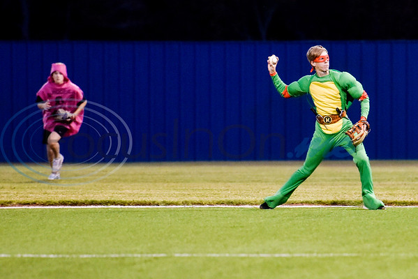 A Lindale player dressed as a whoopee cushion runs as his teammate dressed as a teenage mutant ninja turtle throws the ball during the Lindale High School baseball Halloween game in Lindale Texas, on Tuesday, Oct. 30, 2018. Athletes played in Halloween costumes and kids were able to run the bases to collect candy before the game. (Chelsea Purgahn/Tyler Morning Telegraph)