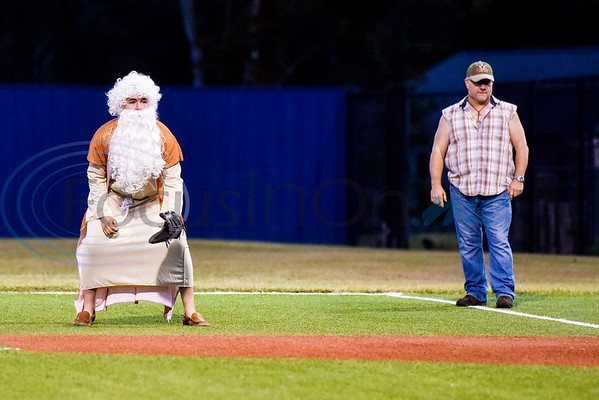 A Lindale baseball player dressed as Moses and an umpire dressed as Larry the Cable Guy stand at first base during the Lindale High School baseball Halloween game in Lindale Texas, on Tuesday, Oct. 30, 2018. Athletes played in Halloween costumes and kids were able to run the bases to collect candy before the game. (Chelsea Purgahn/Tyler Morning Telegraph)