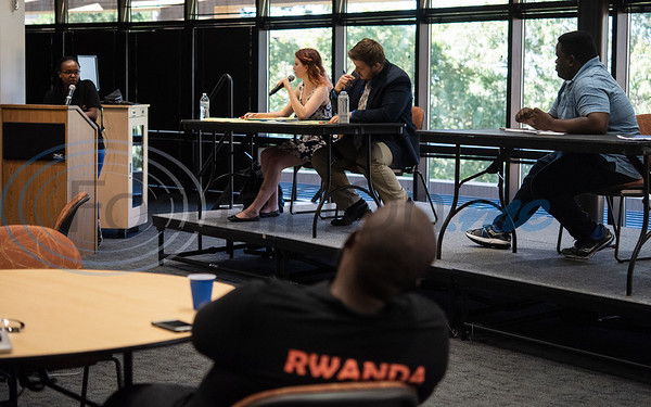 Melodie Lamborn, second from left, cross examines Kellia Kaneze, far left, during an exhibition debate on Wednesday Oct. 3, 2018 between the University of Texas at Tyler's Patriot Debate Team and iRwanda, an NGO team from Rwanda that is touring the United States.  (Sarah A. Miller/Tyler Morning Telegraph)