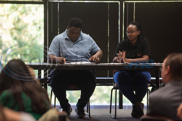 iRwanda's Ndayiyenga Mekha Rousseau and Kellia Kaneze prepare for the start of an exhibition debate on Wednesday Oct. 3, 2018 between the University of Texas at Tyler's Patriot Debate Team and iRwanda, an NGO team from Rwanda that is touring the United States.  (Sarah A. Miller/Tyler Morning Telegraph)