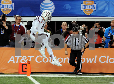 photo by Sarah A. Miller/Tyler Morning Telegraph  Texas A&M's (2) Johnny Manziel makes his first TD of game at the AT&T Cotton Bowl Classic Friday in Arlington.