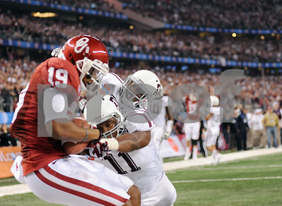 photo by Sarah A. Miller/Tyler Morning Telegraph  Oklahoma Sooner's (19) Justin Brown scores a TD and is followed into the end zone by Texas A&M Aggies' (11) Jonathan Stewart and (29) Deshazor Everett at the AT&T Cotton Bowl Classic Friday night at Cowboys Stadium in Arlington.