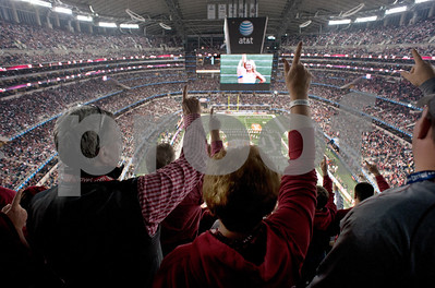 photo by Sarah A. Miller/Tyler Morning Telegraph  Oklahoma Sooner fans sing along to the marching band during the pre game show at the Cotton Bowl at Cowboys Stadium in Arlington Friday night.