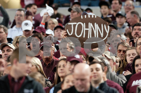 "photo by Sarah A. Miller/Tyler Morning Telegraph  Fans at the Cotton Bowl hold a sign for Texas A&M's ""Johnny Football"" Johnny Manziel at Cowboys Stadium in Arlington Friday night."