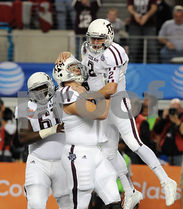 photo by Sarah A. Miller/Tyler Morning Telegraph  Texas A&M's (2) Johnny Manziel celebrates his first TD of game with teammate (25) Ryan Swope at the AT&T Cotton Bowl Classic Friday in Arlington.