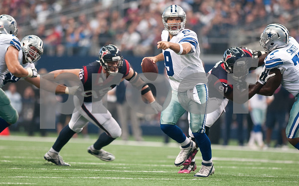 photo by Sarah A. Miller/Tyler Morning Telegraph  Dallas Cowboy's quarterback Tony Romo (9) waits to make a pass as they played Houston Texans Sunday Oct. 5, 2014 at AT&T Stadium in Arlington.