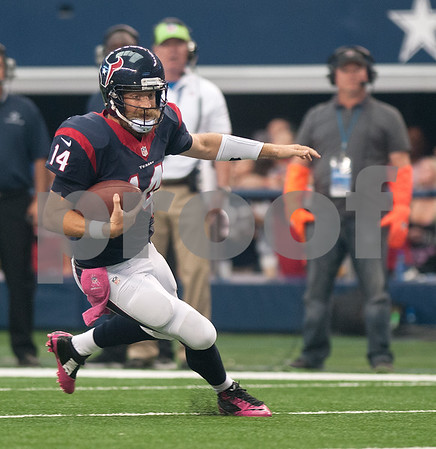 photo by Sarah A. Miller/Tyler Morning Telegraph  Houston Texans quarterback Ryan Fitzpatrick (14) carries the ball in the fourth quarter as they played the Dallas Cowboys Sunday Oct. 5, 2014 at AT&T Stadium in Arlington.
