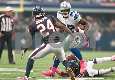 photo by Sarah A. Miller/Tyler Morning Telegraph  Dallas Cowboy's Dez Bryant (88) makes it past Houston Texan's D.J. Swearinger (36) before being stopped by Johnathan Joseph (24) Sunday Oct. 5, 2014 at AT&T Stadium in Arlington.