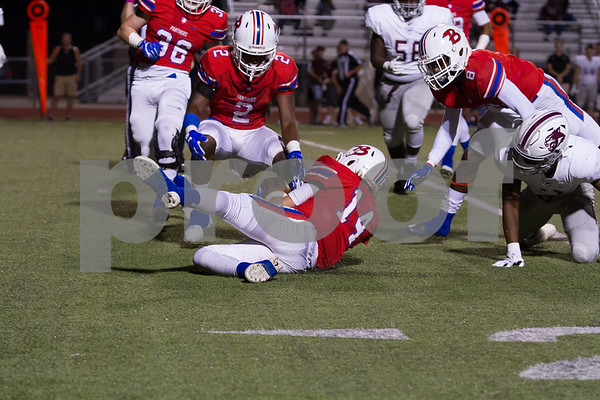Panther #14 Landry Lasseter recovers a Wildcat fumble early in the first quarter. Photo by John Murphy