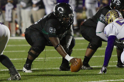 Connally's Hayden Washington gets ready to snap the ball against Montgomery in the first round of the Division 1 playoffs Friday at Cougar Stadium.