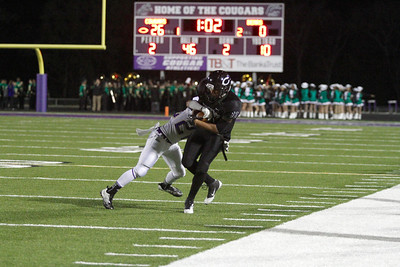 Connally's Davon Martin is pushed out of bounds by a Montgomery player in the first round of the Division 1 playoffs Friday at Cougar Stadium.