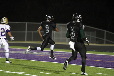 Connally's Dajon Williams runs for a 26 yard touchdown against Montgomery in the first round of the Division 1 playoffs Friday at Cougar Stadium.
