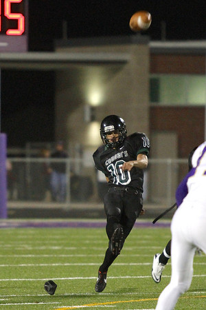 Connally's Daniel Portillo kicks off against Montgomery in the first round of the Division 1 playoffs Friday at Cougar Stadium.