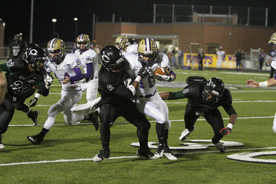 Connally's Darrell Songy tackles Montgomery's Jared Eaton in the first round of the Division 1 playoffs Friday at Cougar Stadium.