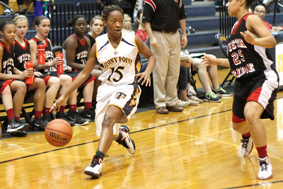 Stony Point's Niecy Washington dribbles the ball up court against Vista Ridge Monday at Stony Point High School.