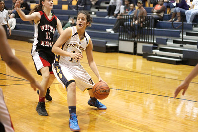 Stony Point's Miranda Simpson looks for space against Vista Ridge Monday at Stony Point High School.