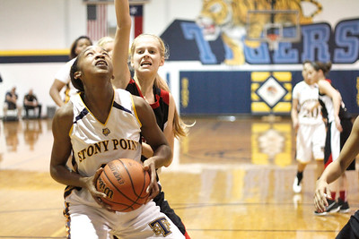 Stony Point's Jordan Moore drives to the hoop against Vista Ridge Monday at Stony Point High School.