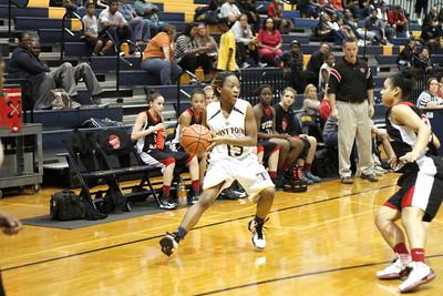 Stony Point's Niecy Washington dribbles the ball up court against Vista Ridge Monday at Stony Point High School.