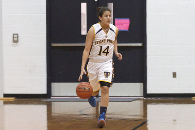 Stony Point's Miranda Simpson dribbles the ball up court against Vista Ridge Monday at Stony Point High School.