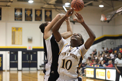 Stony Point's Orianna Shillow  drives to the hoop against Vista Ridge Monday at Stony Point High School.