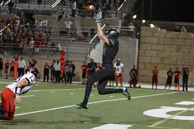 Cedar Park's Samuel Brock catches a touchdown pass in the end zone Friday at Gupton Stadium.