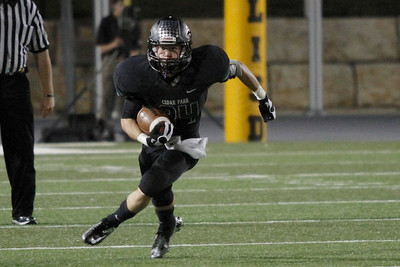Cedar Park's Nathan Harwell makes a run against Vista Ridge  Friday at Gupton Stadium.