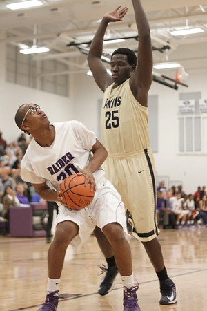 Cedar Ridge's J Payne maneuvers for an open shot against Akins Tuesday at Cedar Ridge High School.