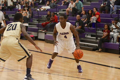 Cedar Ridge's DD Harris looks for open space against Akins Tuesday at Cedar Ridge High School.