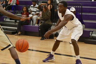 Cedar Ridge's DD Harris passes the ball to a teammate against Akins Tuesday at Cedar Ridge High School.