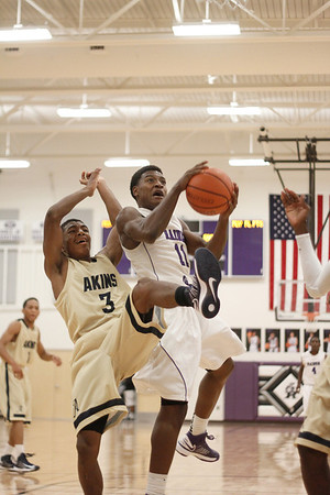 Cedar Ridges De'Andre Davis takes a shot against Akins Tuesday at Cedar Ridge High School.