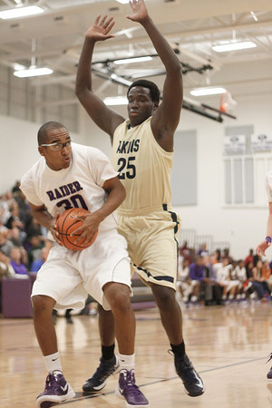 Cedar Ridge's J Payne manuvers for an open shot against Akins Tuesday at Cedar Ridge High School.