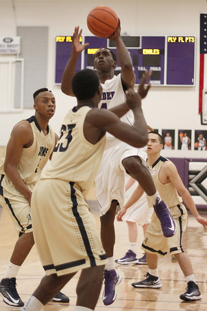 Cedar Ridge's DD Harris takes a shot against Akins Tuesday at Cedar Ridge High School.