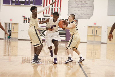 Cedar Ridge's DD Harris battles Akins defenders Tuesday at Cedar Ridge High School.