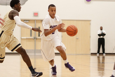 Cedar Ridge's Brice Dudley drives to the hoop against Akins Tuesday at Cedar Ridge High School.