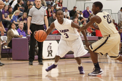 Cedar Ridge's Jashua Rhodes drives past a Akins defender Tuesday at Cedar Ridge High School. maneuvers