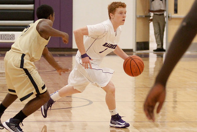 Cedar Ridge's Austin Estelle dribbles past a defender against Akins Tuesday at Cedar Ridge High School.