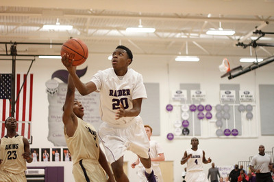 Cedar Ridges J Payne takes a shot against Akins Tuesday at Cedar Ridge High School.