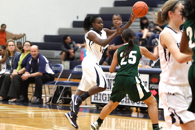 Hendrickson's Jakira Rogers passes the ball up court against Connally at Hendrickson High School on Tuesday.