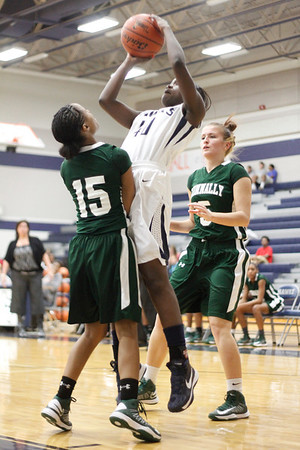 Hendrickson's Aine Ekoh attempts a jump shot between Connally's Bria Freeland, left, and Kara Babola at Hendrickson High School on Tuesday.